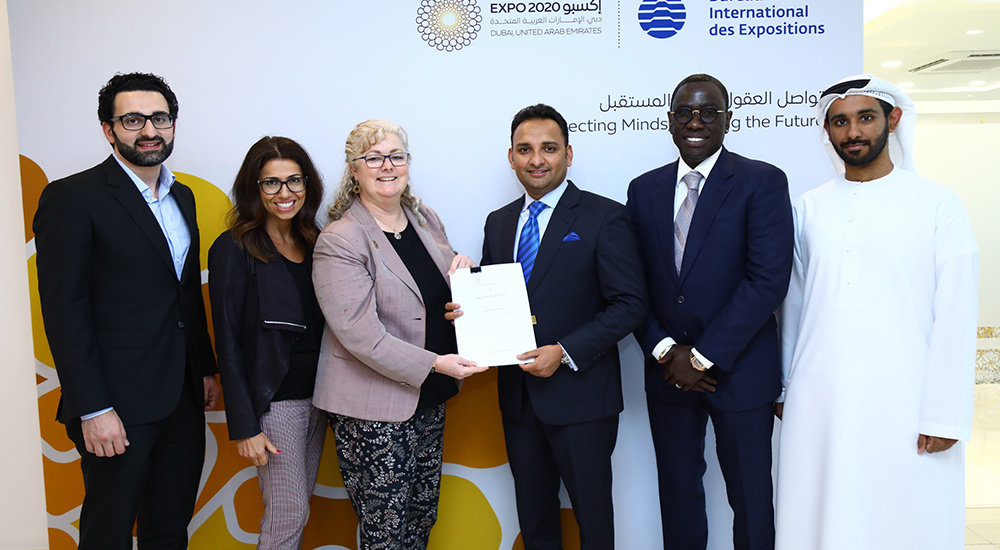 Sajid Barkat, CEO, AS World Group, 3rd from right, being awarded the authorised ticket reseller contract by Lisa Caudana, Director, Ticketing, Sales and Marketing, Expo 2020 Dubai