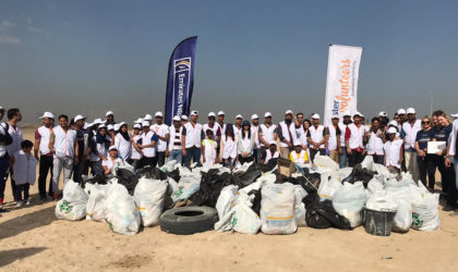 Aster Volunteers, Emirates NBD together clean up plastic in Al Qudra desert