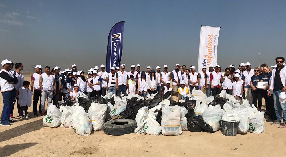 Aster Volunteers, Emirates NBD together clean up plastic in Al Qudra desert