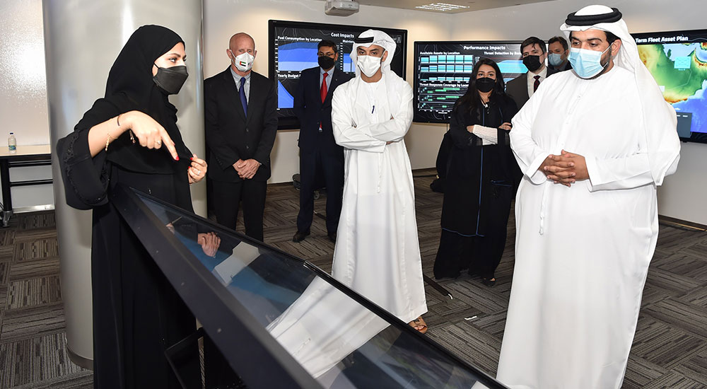 Interns at Lockheed Martin's Center for Innovation and Security Solutions showcase their work to Matar Al Romaithi, Chief Economic Development Officer at Tawazun Economic Council.